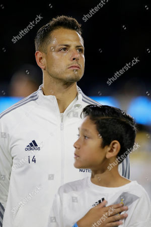 LA Galaxy forward Javier Hernandez (14) stands before an MLS soccer match against the Vancouver Whitecaps in Carson, Calif