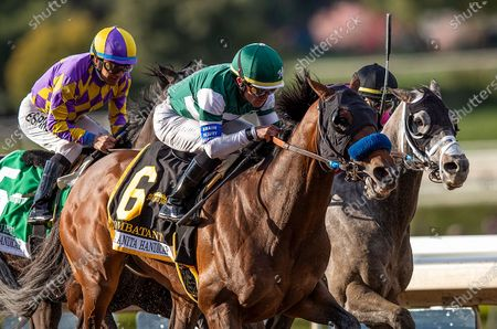 , 2020, Arcadia, California, USA: : Combatant with Joel Rosario uo (left) defeats Midcourt with Victor Espinoza and Multiplier with Tyler Gaffalione to win the Santa Anita Handicap at Santa Anita Park in Arcadia, California on Evers/Eclipse Sportswire/CSM
