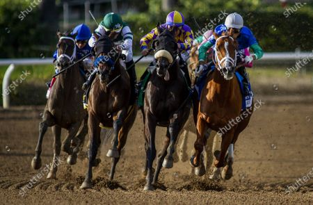 Combatant with Joel Rosario uo (left) defeats Midcourt with Victor Espinoza and Multiplier with Tyler Gaffalione to win the Santa Anita Handicap at Santa Anita Park in Arcadia, California on Evers/Eclipse Sportswire/CSM
