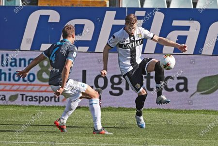 Stock Image of Parma's Riccardo Gagliolo (R) and Spal's Thiago Cionek (L) in action during the Italian Serie A soccer match Parma Calcio vs S.P.A.L at Ennio Tardini stadium in Parma, Italy, 08 March 2020.