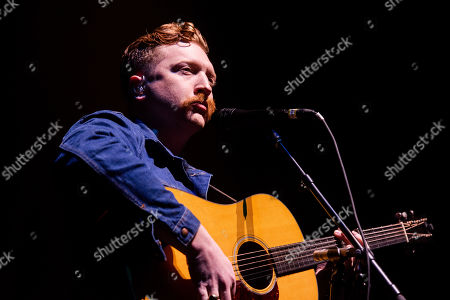 Stock Image of Tyler Childers performs on stage at The Infinite Energy Arena, in Duluth, Ga