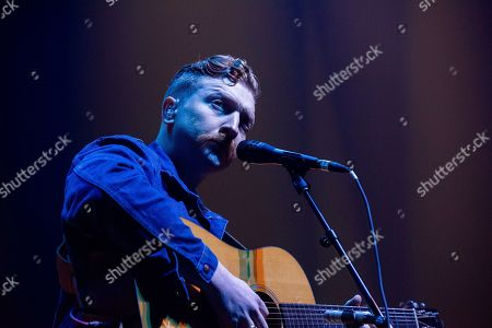 Stock Photo of Tyler Childers performs on stage at The Infinite Energy Arena, in Duluth, Ga