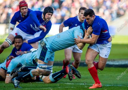 Scotland vs France. Scotland's Scott Cummings tackles France's Arthur Vincent