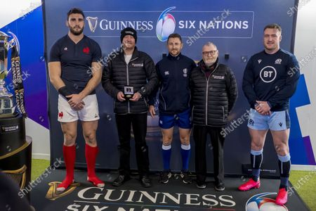 Stock Picture of Scotland vs France. France's captain Charles Ollivon, referee Paul Williams and Scotland's captain Stuart Hogg with competition winners during the coins toss