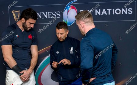 Scotland vs France. France's captain Charles Ollivon, referee Paul Williams and Scotland captain Stuart Hogg during the coin toss