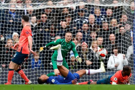 8th March 2020; Stamford Bridge, London, England; English Premier League Football, Chelsea versus Everton; Djibril Sidibe of Everton slide tackles Faustino Anjorin of Chelsea as keeper Pickford comes to collect the loose ball