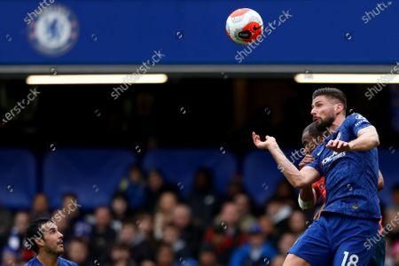 8th March 2020; Stamford Bridge, London, England; English Premier League Football, Chelsea versus Everton; Olivier Giroud of Chelsea wins a header against Djibril Sidibe of Everton