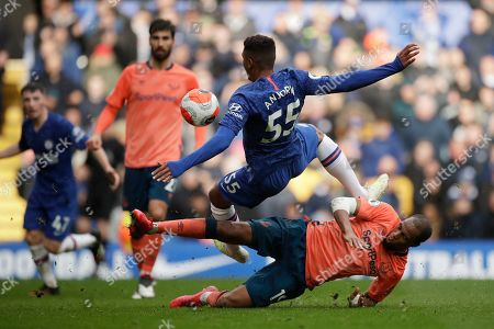 Faustino Anjorin, Djibril Sidibe. Everton's Djibril Sidibe, bottom, and Chelsea's Faustino Anjorin compete for the ball during the English Premier League soccer match between Chelsea and Everton at Stamford Bridge stadium in London