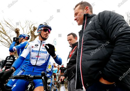 Stock Image of French rider Julian Alaphilippe (L) of the Deceuninck Quick Step team talks with former French rider Thomas Voeckler (R) prior to the first stage of the Paris-Nice cycling race over 154km from Plaisir to Plaisir, France, 08 March 2020.
