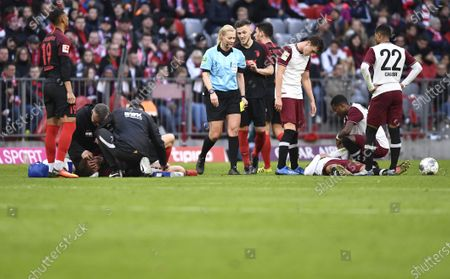 Players look after Augsburg's Alfred Finnbogason (bottom L) and Bayern Munich's Thiago Alcantara (bottom R) during the German Bundesliga soccer match between Bayern Munich and FC Augsburg in Munich, Germany, 08 March 2020.