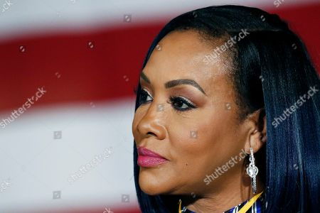 Actress Vivica A. Fox listens as supporters call out for Democratic presidential candidate and former Vice President Joe Biden before he speaks at Tougaloo College in Tougaloo, Miss