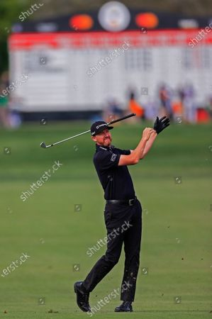 Jimmy Walker of the US releases his golf club as he hits his second shot on the eleventh hole during the fourth round of the Arnold Palmer Invitational golf tournament at Bay Hill Club & Lodge in Orlando, Florida, USA, 08 March 2020.