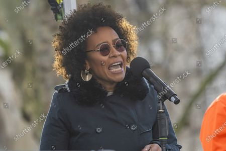 Stock Image of Emeli Sande sings - #March4Women 2020, a march and rally in London to celebrate International Women's Day and the power and passion of women and girls who are on the frontline of responding to climate change. Organised by Care International the march started in Whitehall and ended in a rally in Parliament Square. CARE International works around the globe to save lives, defeat poverty and achieve social justice and #March4Women is a global movement for gender equality.
