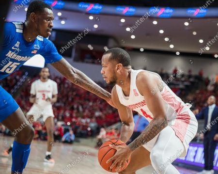 Houston Cougars forward Justin Gorham (4) is defended by Memphis Tigers forward Lance Thomas (15) in the NCAA basketball game between the Memphis Tigers and the Houston Cougars at the Fertitta Center in Houston, Texas. Houston defeated Memphis 64-57. Prentice C