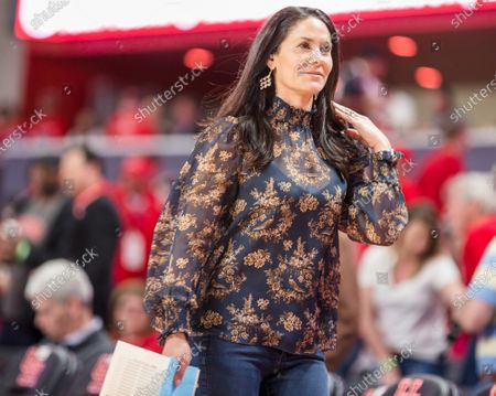 Sports reporter Tracy Wolfson walks the sideline during the NCAA basketball game between the Memphis Tigers and the Houston Cougars at the Fertitta Center in Houston, Texas. Houston defeated Memphis 64-57. Prentice C