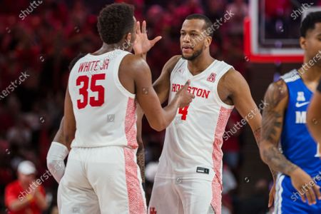 Stock Image of Houston Cougars forward Fabian White Jr. (35) and teammate Justin Gorham (4) celebrate during the NCAA basketball game between the Memphis Tigers and the Houston Cougars at the Fertitta Center in Houston, Texas. Houston defeated Memphis 64-57. Prentice C