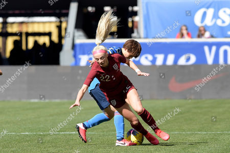 England forward Chloe Kelly (22) its tripped up by Japan defender Asato Miyagawa (16) during the first half of a SheBelieves Cup soccer match, in Harrison, N.J