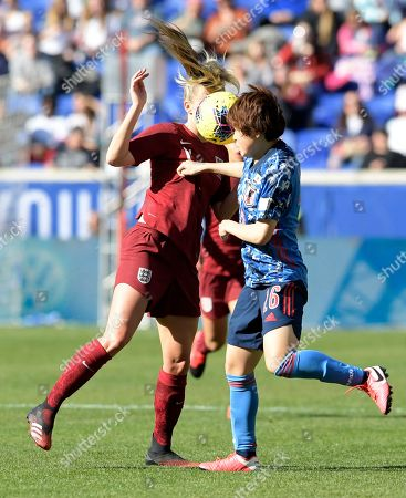 England forward Toni Duggan (11) and Japan defender Asato Miyagawa (16) vie for the ball during the second half of a SheBelieves Cup soccer match, in Harrison, N.J