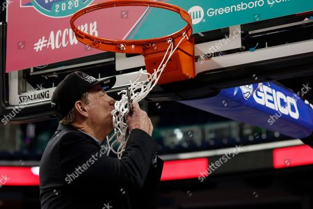 Stock Picture of North Carolina State head coach Wes Moore kisses the net following an NCAA college basketball championship game against Florida State at the Atlantic Coast Conference women's tournament in Greensboro, N.C