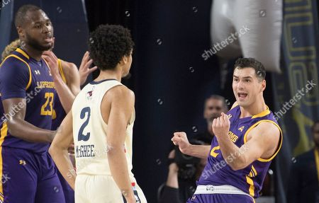 Lipscomb guard Andrew Fleming, right, pumps his fist after scoring a basket against Liberty during the first half of the Atlantic Sun conference NCAA basketball championship game in Lynchburg, Va