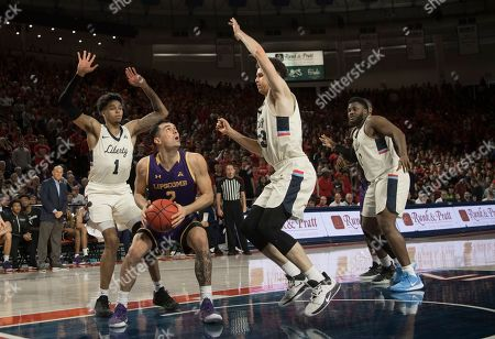 Stock Image of Lipscomb guard Andrew Fleming (2) is double-teamed by Liberty defenders Caleb Homesley (1) and Shiloh Robinson (33) during the first half of the Atlantic Sun Conference NCAA basketball championship game in Lynchburg, Va