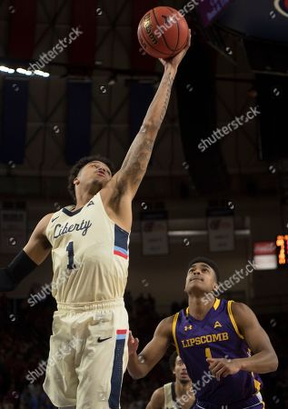 Liberty guard Caleb Homesley, left, grabs a one-handed rebound in front of Lipscomb defender Greg Jones, right, during the second half of the Atlantic Sun Conference NCAA basketball championship game in Lynchburg, Va