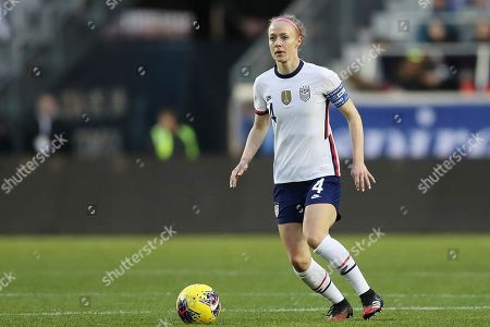 United States defender Becky Sauerbrunn (4) looks to pass the ball during the second half of a SheBelieves Cup soccer match against Spain, in Harrison, N.J. The United States won 1-0