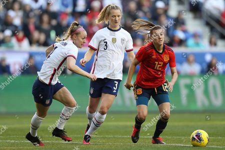 Spain midfielder Patricia Guijarro (12) moves the ball away from United States defender Becky Sauerbrunn (4) and United States midfielder Sam Mewis (3) during the first half of a SheBelieves Cup soccer match, in Harrison, N.J. The United States won 1-0