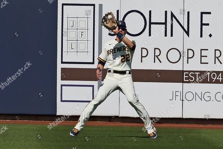 Milwaukee Brewers right fielder Christian Yelich (22) catches a fly ball hit by Los Angeles Angels' Jason Castro for an out in the fourth inning of a spring training baseball game, in Phoenix
