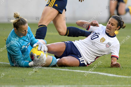 United States forward Carli Lloyd (10) slides into Spain goalkeeper Sandra Paños (13) as she makes a save during the first half of a SheBelieves Cup soccer match, in Harrison, N.J