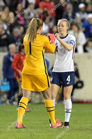 United States defender Becky Sauerbrunn (4) and United States goalkeeper Alyssa Naeher (1) celebrate after defeating Spain 1-0 during a SheBelieves Cup soccer match, in Harrison, N.J