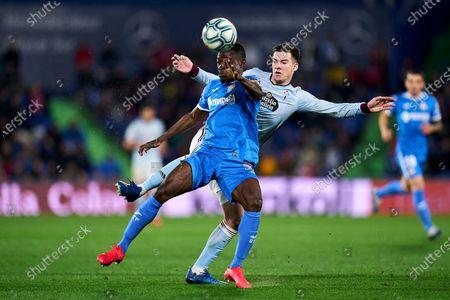Stock Image of Oghenekaro Etebo of Getafe FC and Fedor Smolov of RC Celta de Vigo