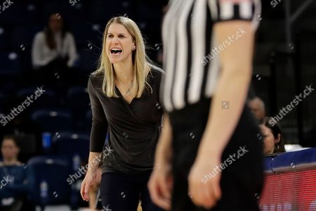 Marquette head coach Megan Duffy calls her team during the second half of an NCAA college basketball game against St. John's in the Big East women's tournament semifinals, in Chicago. Marquette won 78-55