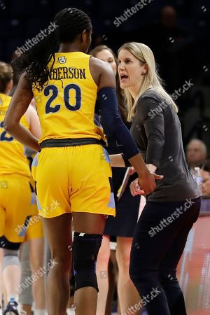 Megan Duffy, Altia Anderson. Marquette head coach Megan Duffy, right, talks with forward Altia Anderson during the second half of an NCAA college basketball game against St. John's in the Big East women's tournament semifinals, in Chicago. Marquette won 78-55
