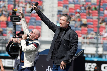 Country music singer and television personality Blake Shelton, right, and singer, songwriter Pitbull perform prior to a NASCAR Cup Series auto race at Phoenix Raceway, in Avondale, Ariz