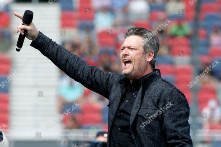 Country music singer and television personality Blake Shelton performs prior to a NASCAR Cup Series auto race at Phoenix Raceway, in Avondale, Ariz