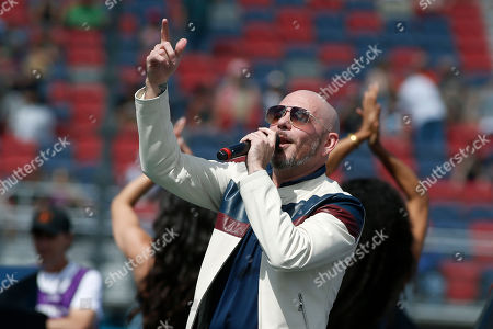 Singer, songwriter Pitbull performs prior to a NASCAR Cup Series auto race at Phoenix Raceway, in Avondale, Ariz