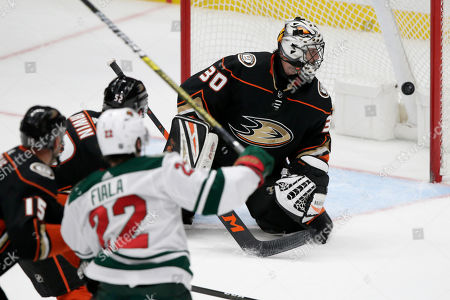 Stock Image of Anaheim Ducks goaltender Ryan Miller, right, watches as the puck gets by for a goal on a shot by Minnesota Wild left wing Kevin Fiala (22), of Switzerland, with center Ryan Getzlaf, left, and defenseman Matt Irwin (52) also watching during the third period of an NHL hockey game in Anaheim, Calif., . The Wild won 5-4
