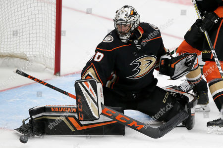 Stock Photo of Anaheim Ducks goaltender Ryan Miller (30) makes a save during the third period of an NHL hockey game against the Minnesota Wild in Anaheim, Calif