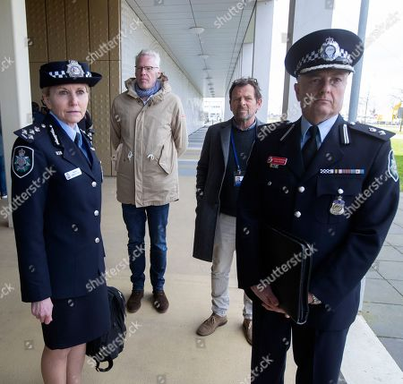 Jennifer Hurst, left and David Nelson, right, of the Australian Metropolitan Police wait to enter the court to attend the trial of four men charged with murder over the downing of Malaysia Airlines flight 17, at Schiphol airport, near Amsterdam, Netherlands, . A missile fired from territory controlled by pro-Russian rebels in Ukraine in 2014, tore the MH17 passenger jet apart killing all 298 people on board