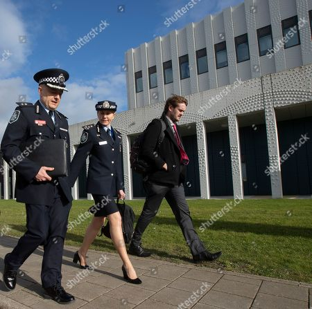 Stock Image of Jennifer Hurst, center and David Nelson, left, of the Australian Metropolitan Police leave the court after attending the start of the trial of four men charged with murder over the downing of Malaysia Airlines flight 17, at Schiphol airport, near Amsterdam, Netherlands, . A missile fired from territory controlled by pro-Russian rebels in Ukraine in 2014, tore the MH17 passenger jet apart killing all 298 people on board