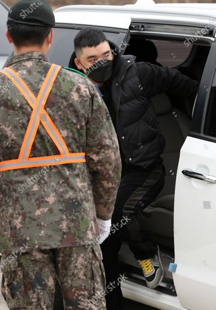 Stock Photo of Seungri, a former member of K-pop boy band BIGBANG, wearing a face mask arrives at a boot camp in Cheorwon, northeast of Seoul, South Korea, 09 March 2020, to begin his mandatory military service. He has been accused of habitually gambling and arranging sex services for foreign acquaintances, and the military court will continue to handle the charges.