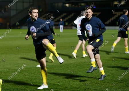 Ben Fox of Burton Albion  warms up in the EFL day of action t shirt