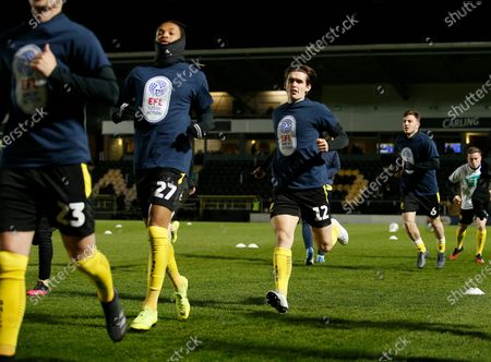 Ben Fox of Burton Albion warms up in the EFL day of action top