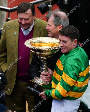 Barry Geraghty on board Epatante celebrates winning the Unibet Champion Hurdle with trainer Nicky Henderson and owner JP McManus