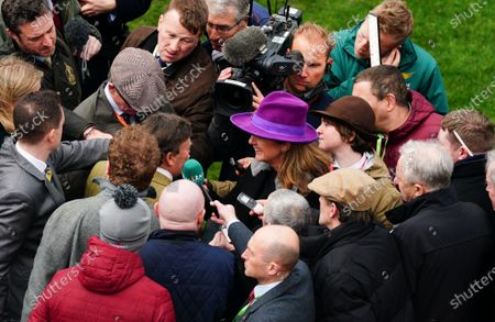 Stock Photo of ITV Presenter Alice Plunkett interviews trainer Nicky Henderson after his win in the feature race, the Champion Hurdle, with Epatante ridden by Barry Geraghty