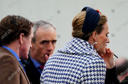 Francesca Cumani has lip-gloss applied in front of AP McCoy and Ruby Walsh