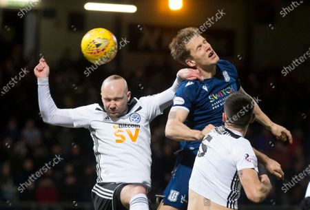 10th March 2020; Dens Park, Dundee, Scotland; Scottish Championship Football, Dundee FC versus Ayr United; Christophe Berra of Dundee competes in the air with Grant Gillespie of Ayr United