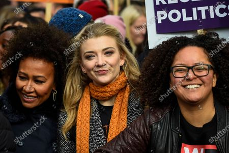 Stock Photo of Emeli Sande (L), singer, and Natalie Dormer (C), actress, join thousands of people in the annual March 4 Women on International Women's Day. The event this year celebrates the power and passion of women and girls who are on the frontline of responding to climate change. The walk through central London from Whitehall Place ends with a rally in Parliament Square.