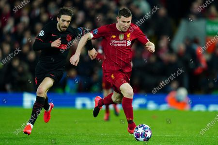Santiago Arias of Atletico Madrid chases James Milner of Liverpool